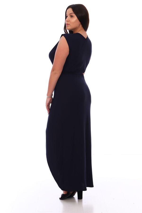 Платье Платье женское трикотажное полуприлегающего силуэта, с имитацией запаха. В плечевых швах и по линии талии резинка, драпирующая ткань мягкими складками. Нижние края запаха полочки закруглённые.